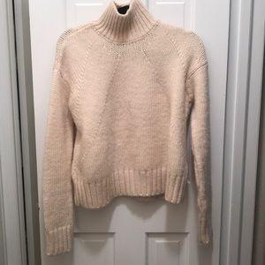 Cable knit turtleneck